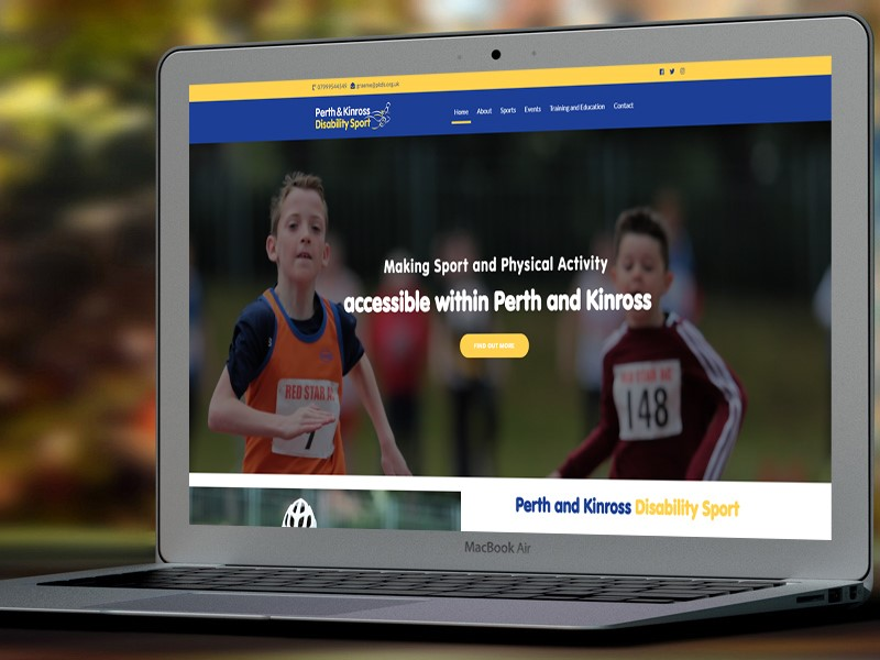 Image shows the home page of Perth and Kinross Disability Sport's website on a MacBook Air